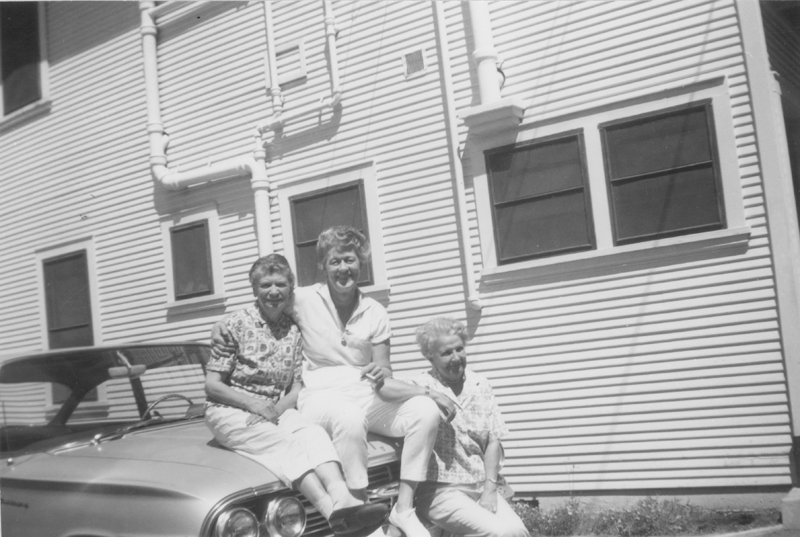 Dorothy Putnam, Geri, and Lois Mercer sitting on a car. Undated.