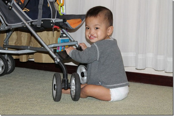 So adorable, even when he's banging the stroller into the lamp.