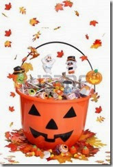 10762286-halloween-pumpkin-bucket-with-candy-and-falling-leaves