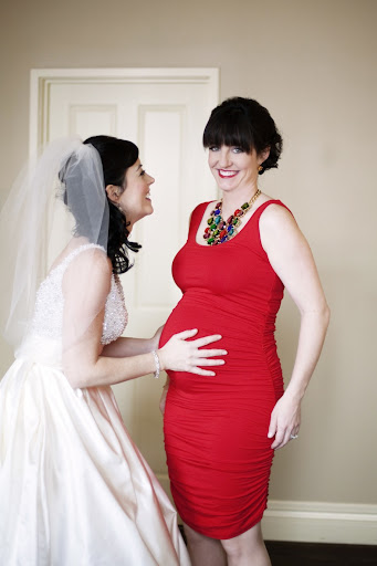 My sister and matron of honor, Maggie Storino, was 8 months pregnant at our wedding. How gorgeous does she look in this rockin' red dress by Isabella Oliver?