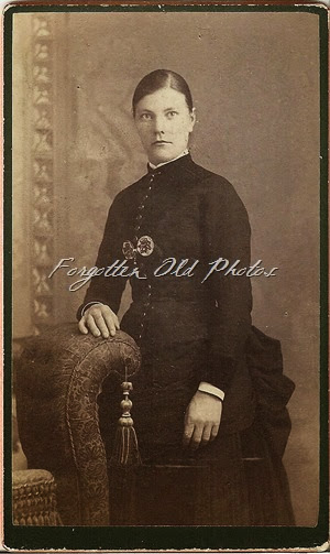 CdV Lady with strange trim on dress DL Antiques