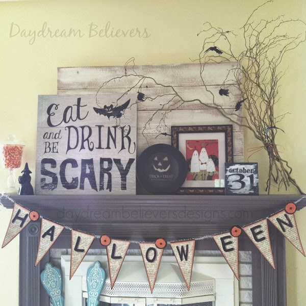 Halloween Mantle with Framed Art and fresh twigs