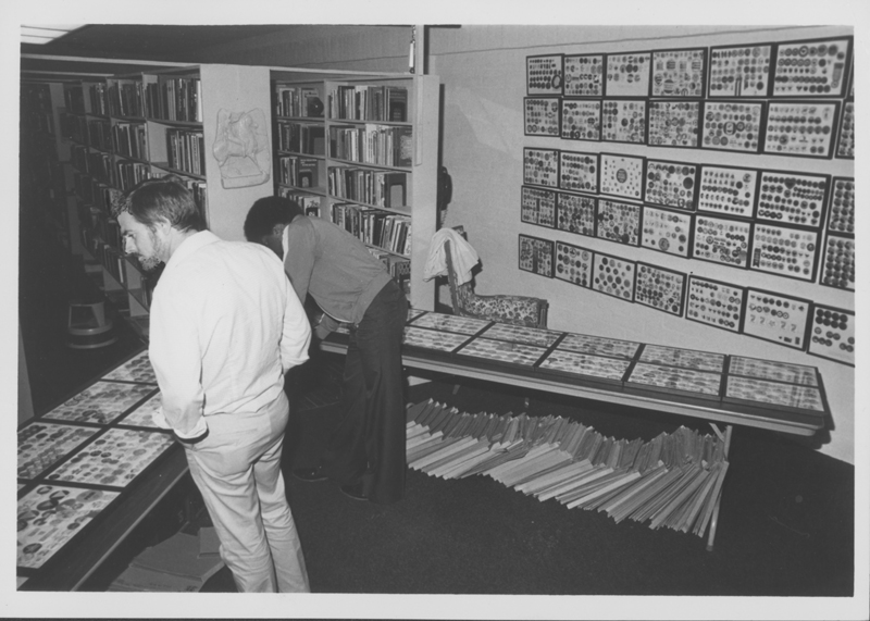 Jeff Horton and Larry Pickels survey John O'Brien's button collection at the National Gay Archives. 1980.
