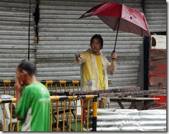Typhoon Yolanda Leyte Store owner protecting from looters - Francis Malasig EPA