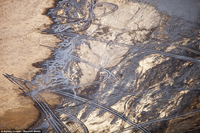 Aerial view of tailings ponds at the Alberta Tar Sands mine, 17 October 2012. Ashley Cooper / Barcroft Media