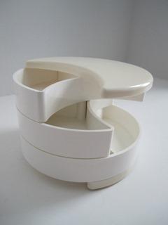 Crescent shaped, plastic swivel drawer box