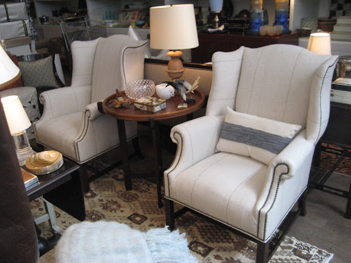 Two things I love about these wing chairs: alternation of vertical and horizontal lines and nail heads that enhance the unusual curves of the chairs form.