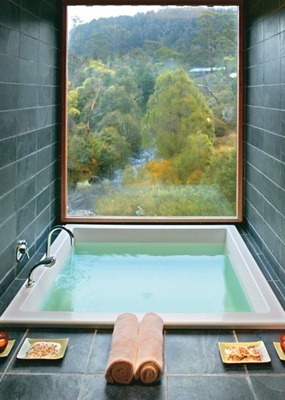 rectangular soaker tub japanese style grey tile zen bathroom with large picture window