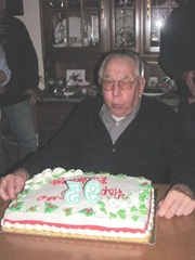 12.10.2011 dads 93rd bday dad blowing out candles cake