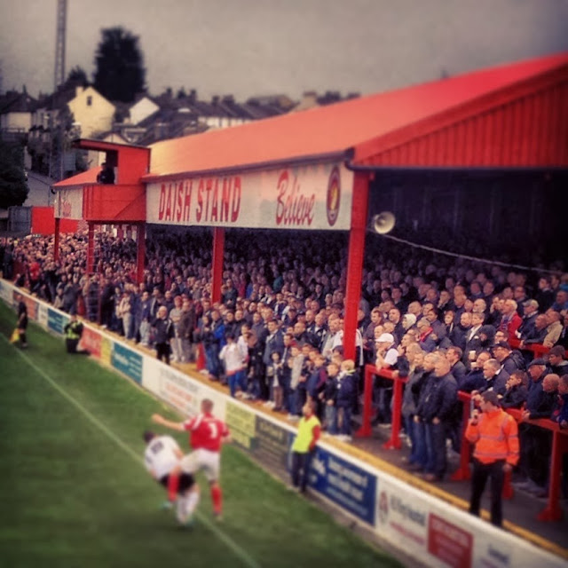 Expectant faces in the Stonebridge Road stand