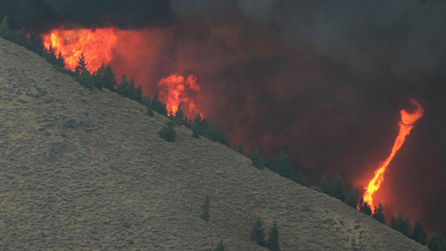 A fire whirl highlights the eratic wind conditions from the 64,000 acre Beaver Creek Fire on Friday, 16 August 2013 north of Hailey, Idaho. A number of residential neighborhoods have been evacuated because of the blaze. Photo: Ashley Smith / Times-News