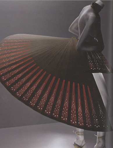 This skirt design is made from wood. It reminds me of a birds tail.