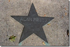 Alan Freed star marker in sidewalk next to marker