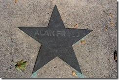 Alan Freed star marker in sidewalk next to marker