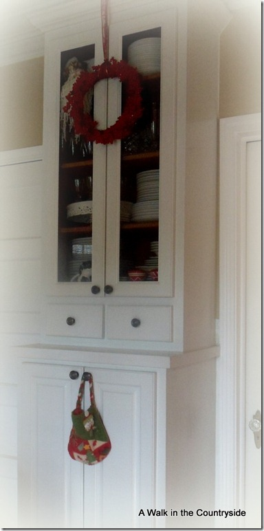a walk in the countryside: christmas wreath on cabinet doors