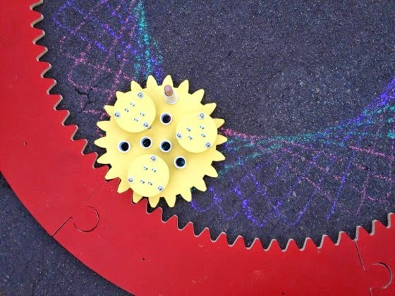 Giant Spirograph Makes Mathematically Perfect Chalk Drawings On The Street via Make
