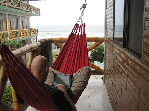 Erik working in the hammock at Charo's Hostal
