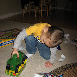 Sam opening his presents 11-3-11 (7).JPG
