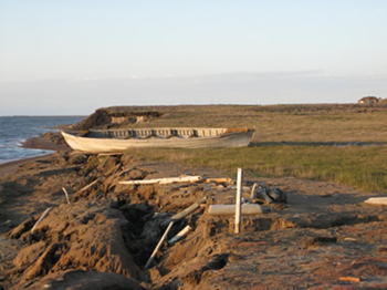USGS researcher took a picture of this nearly century-old whaling boat in July 2007 along the Beaufort Sea coast near Lonely, Alaska. The boat washed away to sea just a few months later. Benjamin Jones / USGS