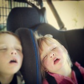 all three children were passed out and asleep in the back of the car