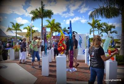 Lots of people admiring the art