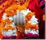 [Radharani holding flowers]