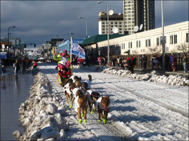 Musher Monica Zappa of Kasilof, Alaska, leads her team past spectators Saturday, 7 March 2015, during the ceremonial start of the Iditarod Trail Sled Dog Race in Anchorage, Alaska. The official start is Monday in Fairbanks, where the race was moved because of a lack of snow to the south. Photo: Rachel D'Oro / AP