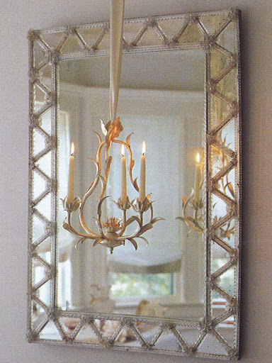 Sparkly objects -- such as this mirror and chandelier -- look especially pretty against muted shades of gray.