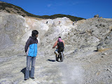 Our guides watches as motorcyclist rides over the Papandayan crater (Daniel Quinn, August 2011)