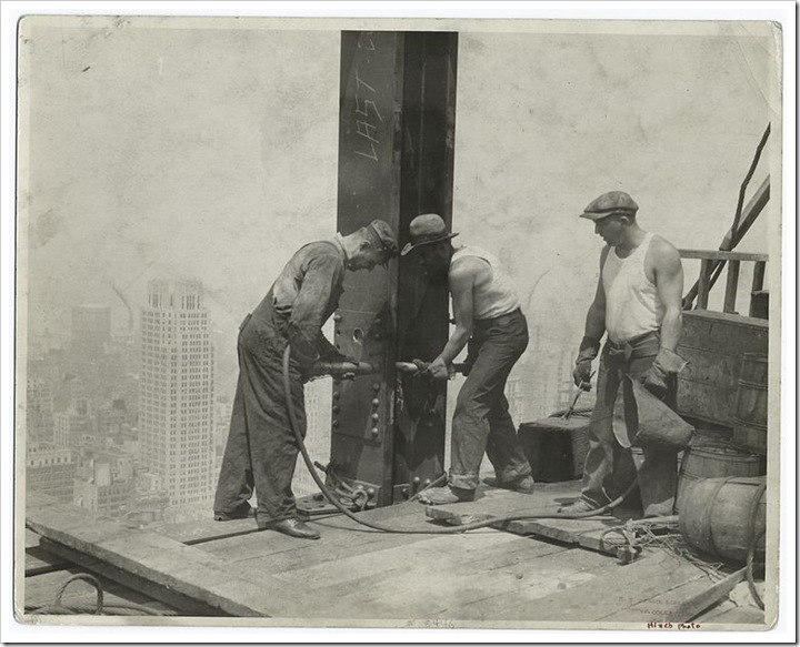 Three-workers-securing-a-rivet-1931