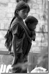 Girl with brother begging