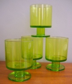 Four transparent lime green glasses by Georges Briard