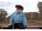 Traditional Owner Reggie Uluru caring for his country on 25th anniversary of Uluru Handback: Uluru Kata Tjuta National Park. <em>© Juno Gemes</em>
