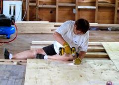 1408050 Aug 04 Barb Screwing Down Floor Plywood