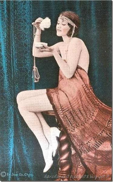 Ziegfeld girl powdering her nose