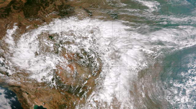 This image from the Suomi NPP satellite's VIIRS sensor from 11 September 2013 shows the storm system that devastated towns in the foothills of the Rockies in central Colorado. The extreme rain and flooding in Colorado was caused when a slow-moving weather system sucked in an unusually large mass of moist air from the Gulf of Mexico, and has been called a '1000-year storm.' Photo: NOAA