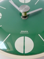 green Krups wall clock