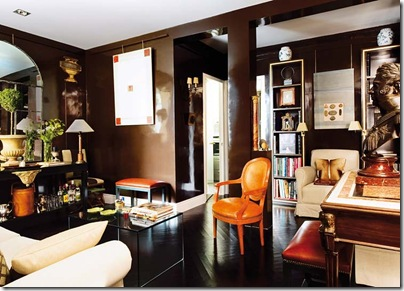 gilded-accents-dark-chocolate-painted-walls-laquer-black-painted-floor-cream-sofa-orange-chair-decorating-ideas-home-decor