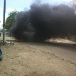 BurningTiresOutsideProperty-PoliceOnStrikeInHaiti.jpg