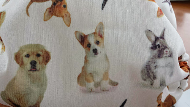 close up of puppies on fabric