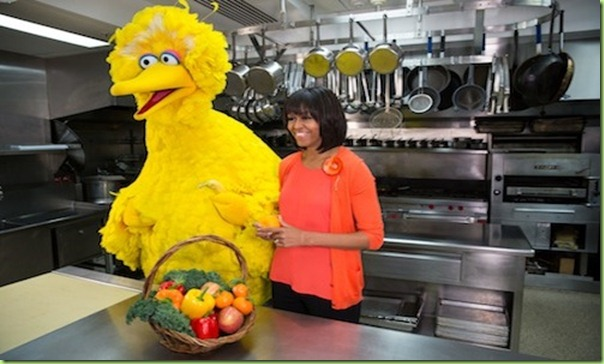 "First Lady Michelle Obama participates in a ""Let's Move!"" and Sesame Street taping with Big Bird in the White House Kitchen, Feb. 13, 2013. (Official White House Photo by Lawrence Jackson)