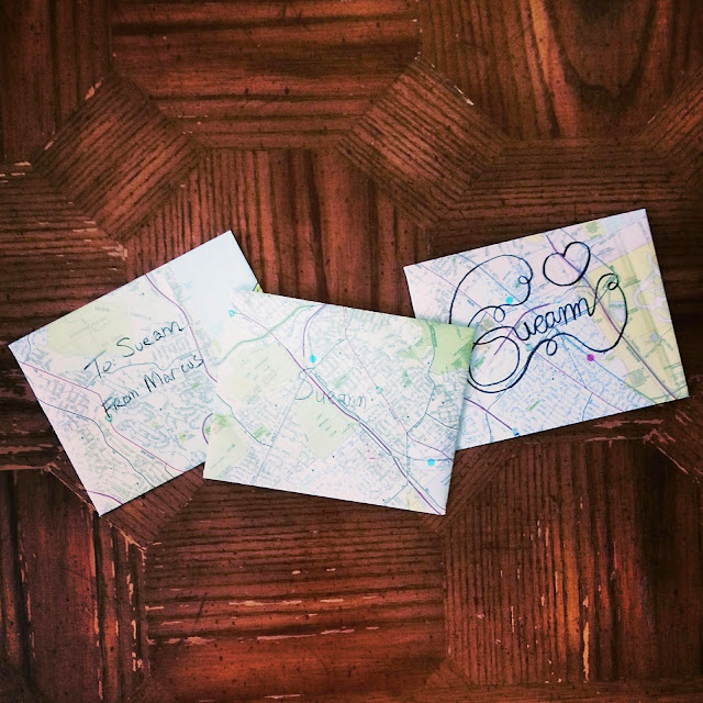 Three envelopes made from maps for a friend.