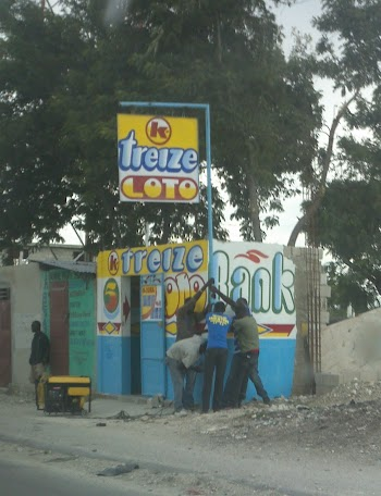 Repairing after Tropical Storm Isaac hit Haiti