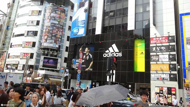 adidas at the shibuya crossing in Shibuya, Tokyo, Japan