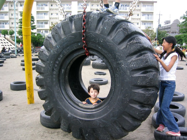 Kai in the biggest tire at the park