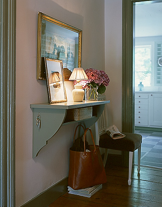 A shelf in an entryway is the perfect landing place for mail, keys, and other everyday items. Dress up your shelf by painting it, adding flowers, a light fixture, mirror and art above.