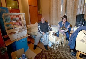 Barry Gladding and partner Mandy Fields have moved into their pet shop on Cleethorpe Road, Grimsby after their home at Barrow Haven Flooded.<br />They sit on their bed made of bird food with parrot Charlie and dogs Sadie and Holly.<br />Picture: Jon Corken<br />Buy this photo at www.thisisphotosales.co.uk/grimsby or by contacting 08444 060910<br />Requested by: News Sam<br />Contact: <br />Date: 07/01/2014<br />Postcode:<br />Keywords: <br /><br /><br />