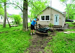 1406034 Jun 04 Terry Shoveling Dirt Into Wheelbarrow