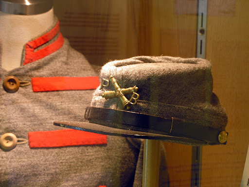 A Confederate artillery kepi and uniform worn by a Pulaski Arkansas Battery member. (Photo credit: Jeremy Shreckhise)