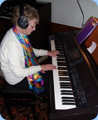 Eileen France having a practice   to get the feel of the piano keyboard
